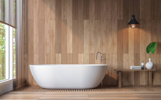 Modern contemporary bathroom 3d rendering image Modern contemporary bathroom 3d rendering image.Decorate wall and floor with wood .There are large windows look out to see the nature bathtub stock pictures, royalty-free photos & images