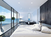 This is modern contemporary bedroom interior with sea background. Wood is the perfect to add a nature look to your home. Here are various shades and finishes that mix together beautifully. And silver is the hottest metallic tone in interior design. Modern lamps bring modern touch to your interior luxury look. A plethora of colors and textures were layered to create a feeling of warmth and luxury style. Fabrics include sumptuous velvet for the sofa, silk cushions and curtain with Italian cashmere carpet.