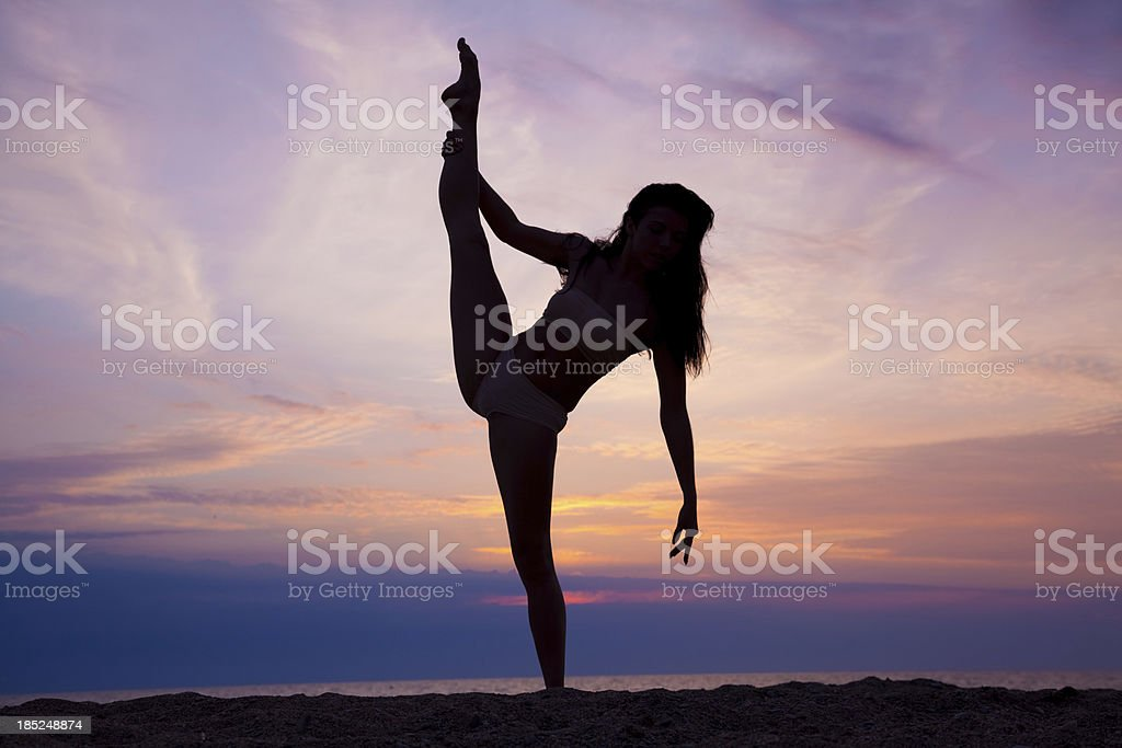 Modern contemporary dance young gymnast woman at sunset beach stock photo