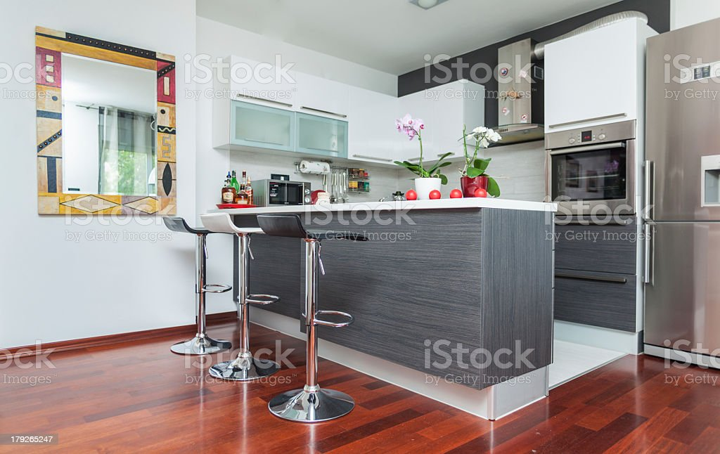 Modern contemporary-style kitchen with fire-tone colors royalty-free stock photo