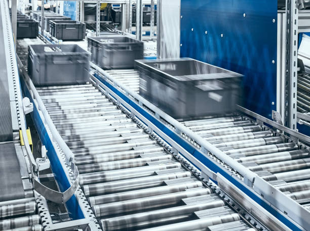Modern conveyor system with boxes in motion. stock photo