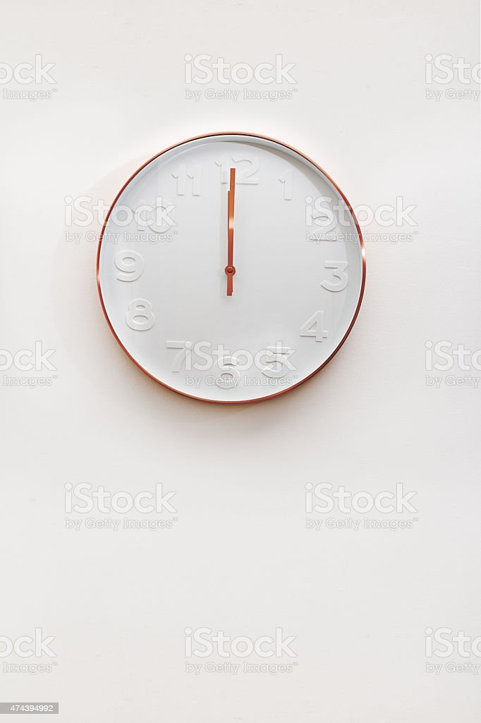 Modern copper and white decorative wall clock stock photo
