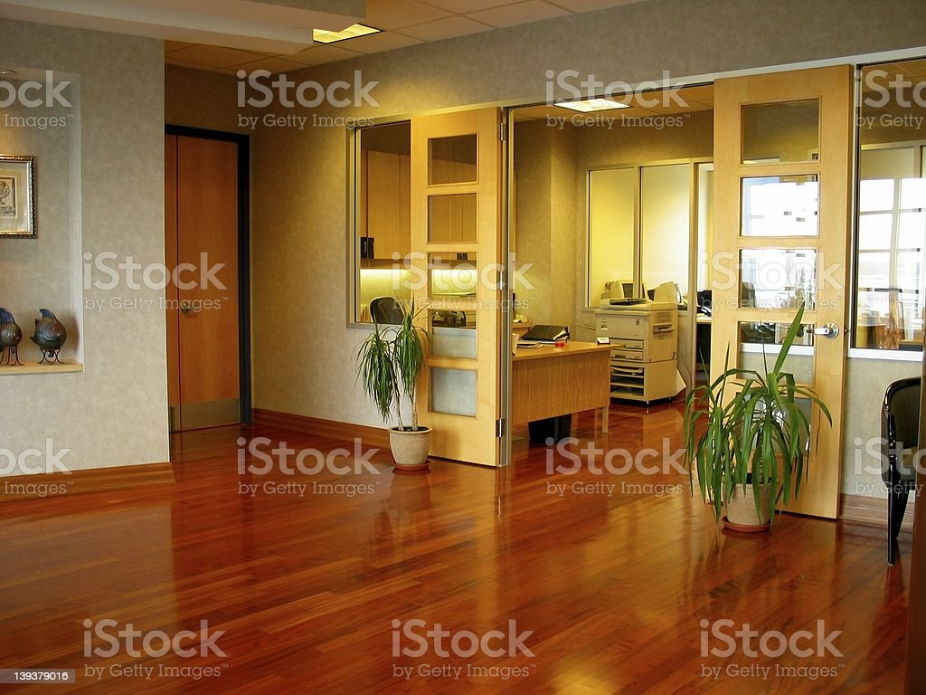 A modern corporate office with a wooden floor royalty-free stock photo