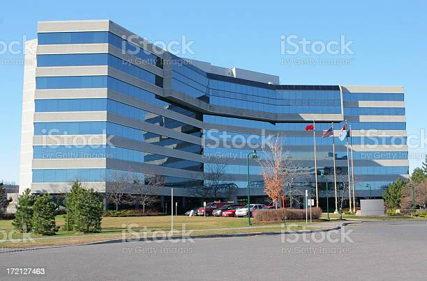 Modern Corporative Building With Flags Stock Photo - Download Image Now