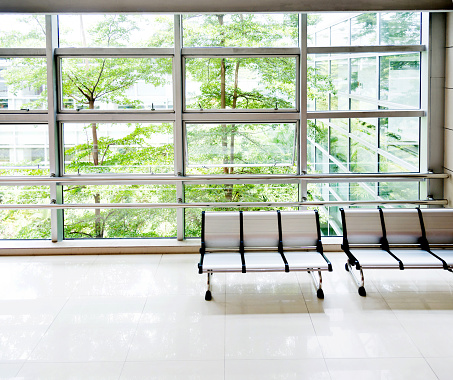 Modern corridor with chairs in office centre.