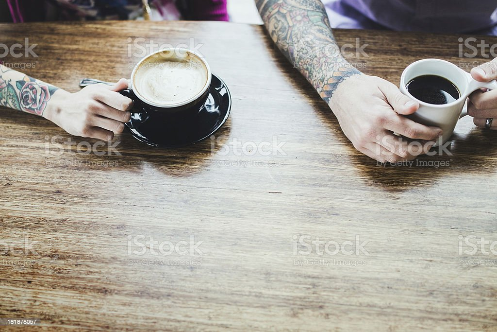 Modern Couple At Coffee Shop royalty-free stock photo