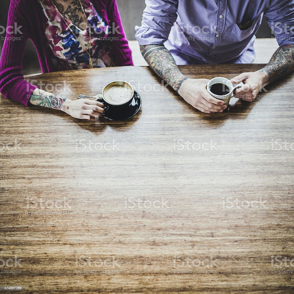 Modern Couple At Coffee Shop stock photo