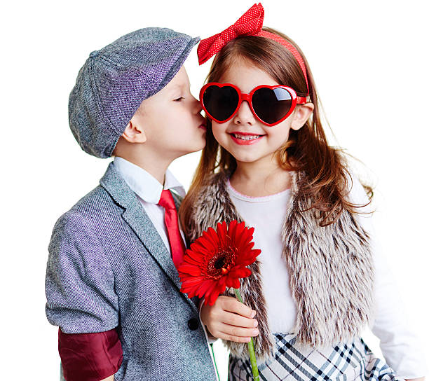 modern couple - little girls little boys kissing love stock photos and pictures