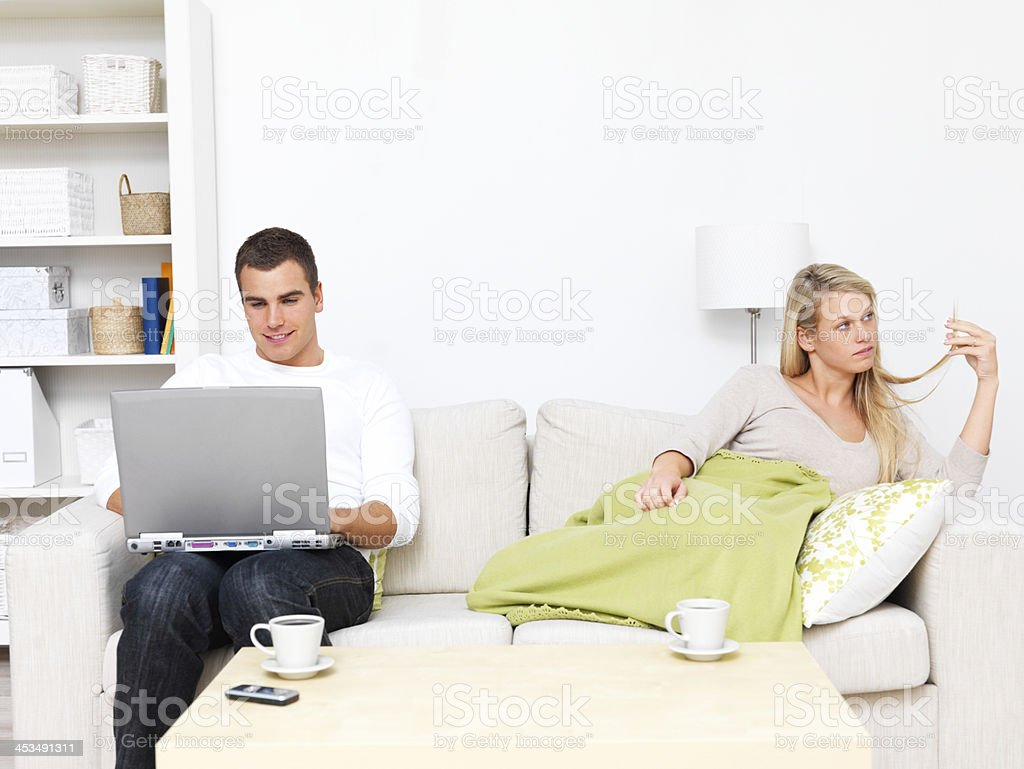 Modern couples - Male computer addiction royalty-free stock photo