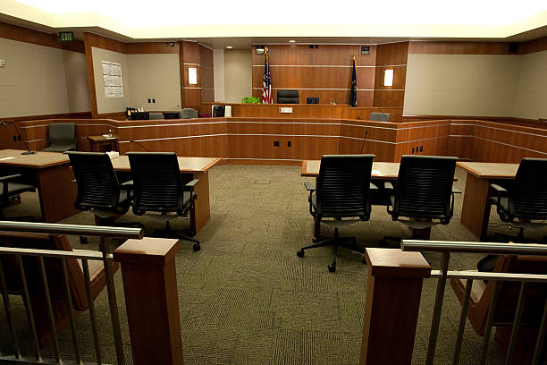 Modern Courtroom Wide Angle from Gallery's Point-of-View Royalty free image showing a wide angle view of a modern courtroom setting from the gallery's point-of-view.  For more images of courtrooms as well as images featuring law and justice themes, click on these thumbnails: courtroom stock pictures, royalty-free photos & images