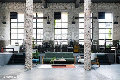 Empty modern open space coworking office - a design studio.