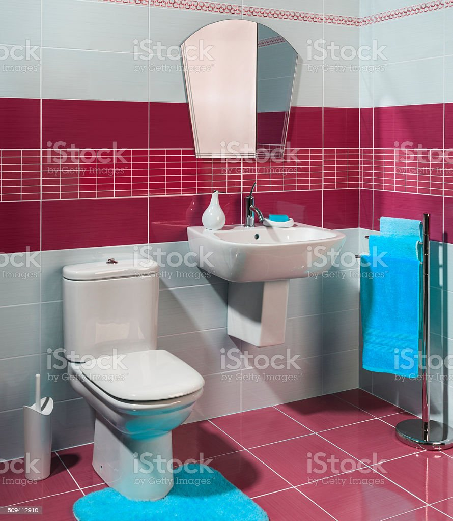modern cozy bathroom with red and white tiles stock photo