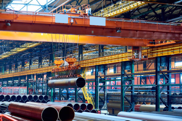 Modern crane moving steel pipe stock photo