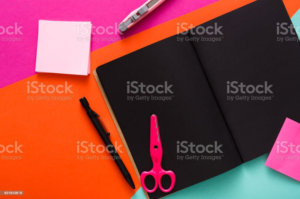 Modern Creative Work Space With Stylish Black Notepad Stock