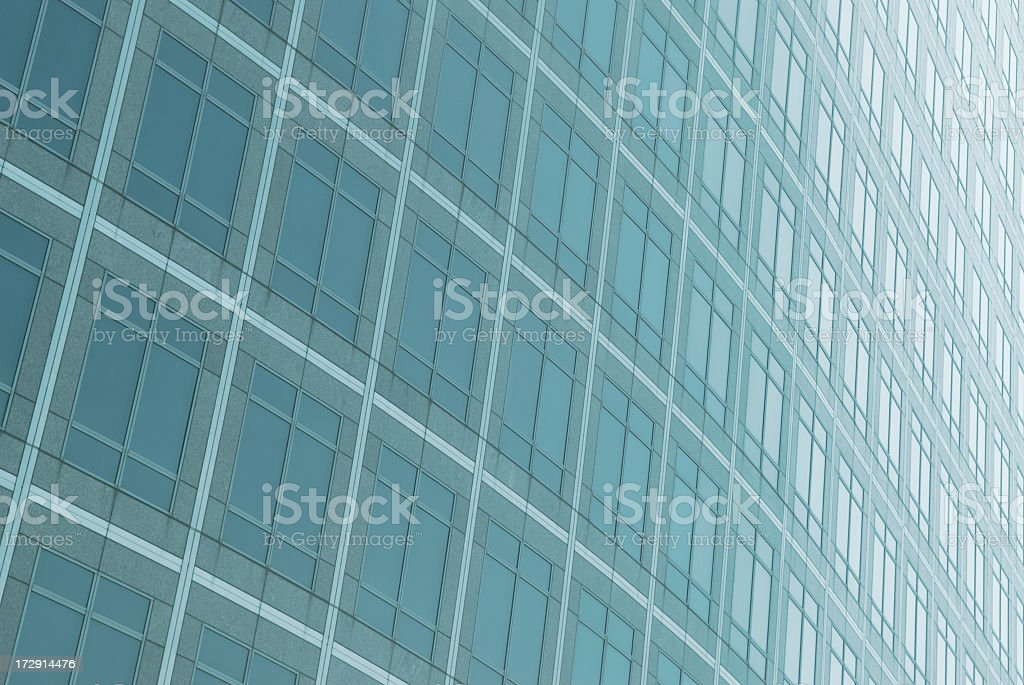 Modern Curving Blue Glass Skyscraper Facade royalty-free stock photo