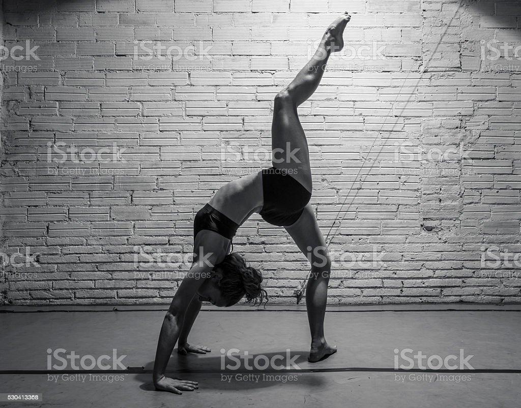 Modern dancer stretching her leg stock photo