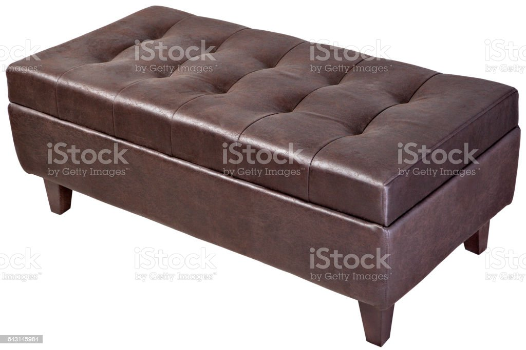 Modern, dark brown, button tufted leatherette bench ottoman upholstered, isolated. stock photo
