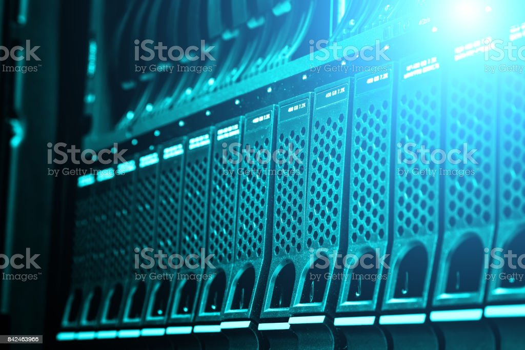 Modern data center disk storage perspective closeup with blue light stock photo