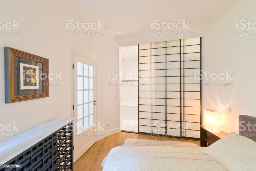 Modern Design Bedroom With Bathroom And Wardrobe Separated By A Japanesestyle Sliding Door Stock Photo Download Image Now Istock