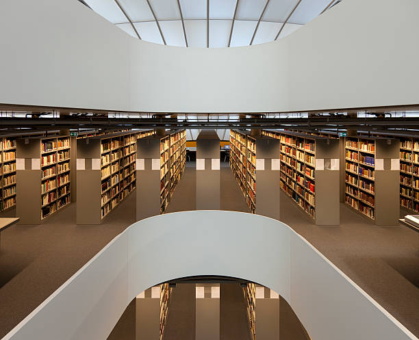 Modern design library with rows of bookshelves stock photo