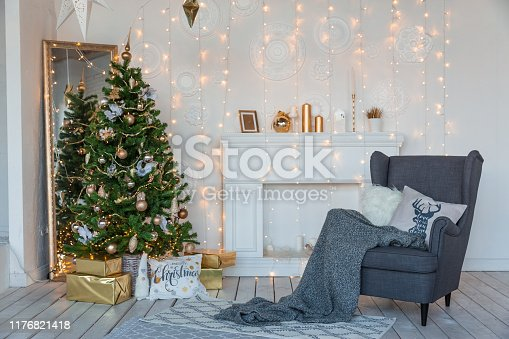 istock Modern design room in light colors decorated with Christmas tree and decorative elements 1176821418