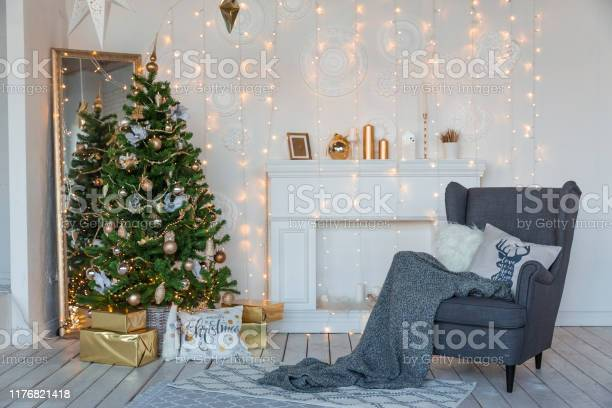 Modern design room in light colors decorated with christmas tree and picture id1176821418?b=1&k=6&m=1176821418&s=612x612&h=quexadvy nvylc9irx9k4qvopoopx9cyp8r7hpidfnu=
