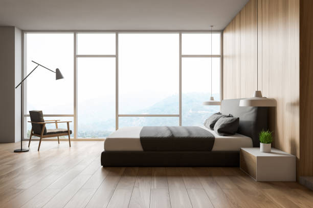 Modern design wooden bedroom interior with window and city view. stock photo