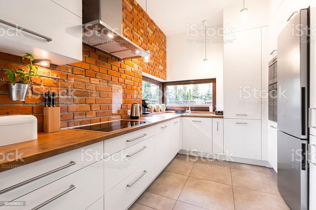 Modern designed kitchen with brick stock photo