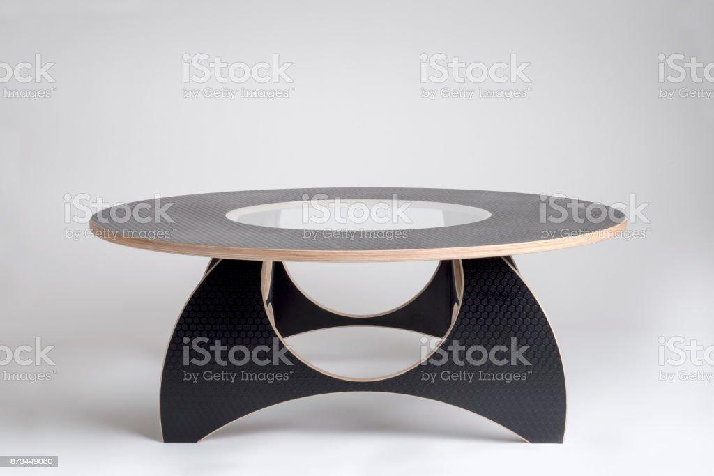 Modern Designer Wooden Round Table in Black Vinyl Covering stock photo