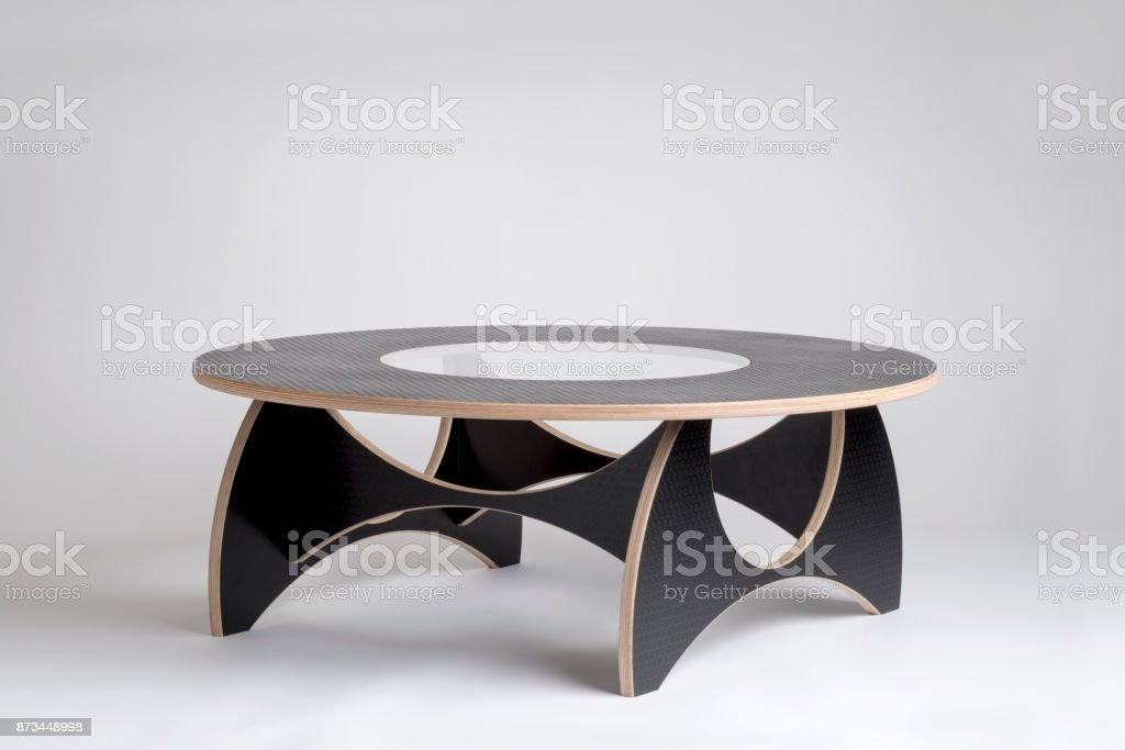 Modern Designer Wooden Round Table in Embossed Rubber Finish stock photo