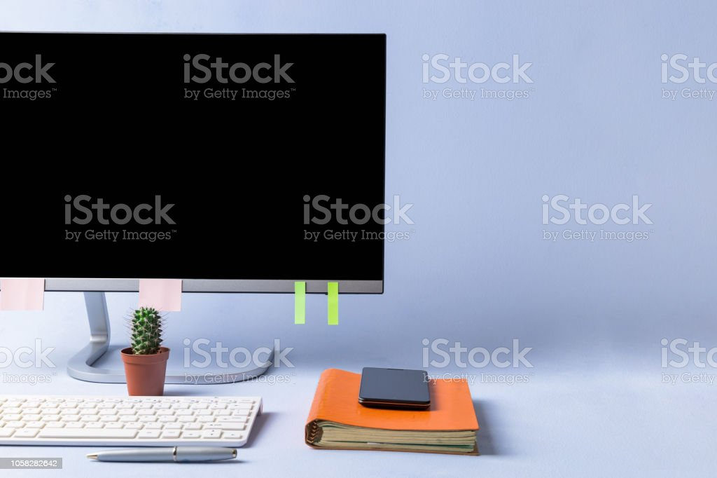 Modern desktop in style minimalism. Monitor screen blank. On a blue...