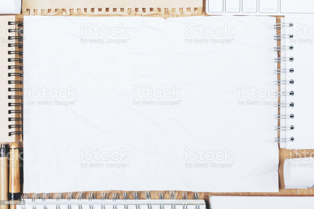 Modern Desktop With Blank Notepad Stock Photo - Download