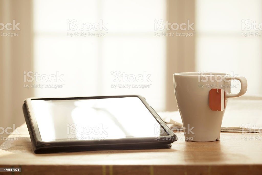 Modern Devices on Wooden Table, Tablet & Tea royalty-free stock photo