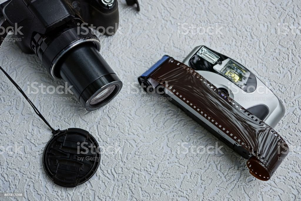 A modern digital camera and an old camera with a film stock photo