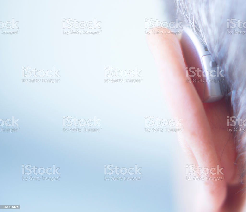 Modern digital in the ear hearing aid for deafness and the hard of hearing patients. stock photo