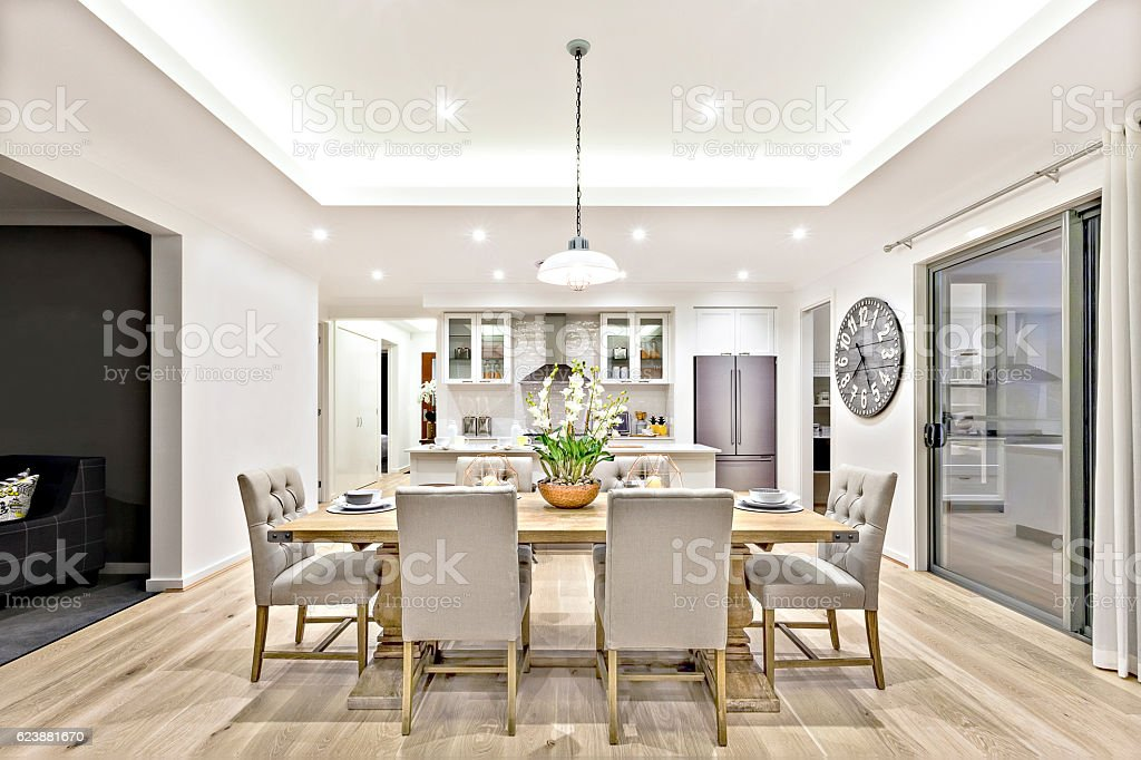 Modern dining room beside the kitchen ready to serve stock photo