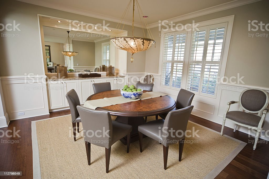 Modern Dining Room Interior with round table & classy Furniture stock photo