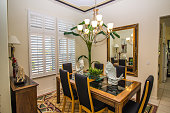 Modern Dining room With Wooden Table, Chairs And Mirror