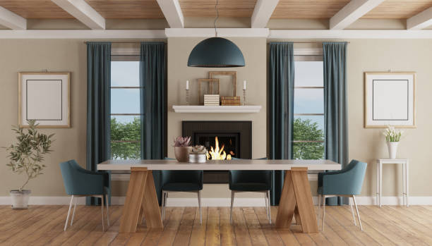 Modern dining table in a classic home interior with fireplace stock photo