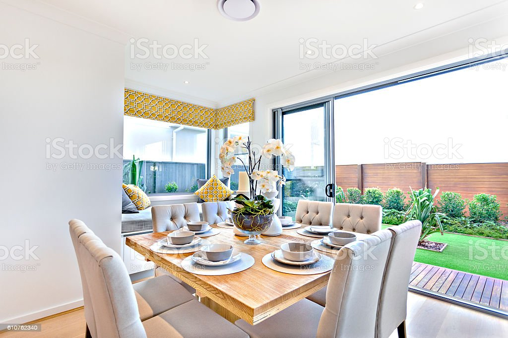 Modern dining table set up indoors with outdoor garden view royalty-free stock photo  sc 1 st  iStock & Modern Dining Table Set Up Indoors With Outdoor Garden View Stock ...