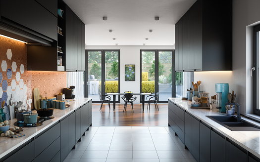 Digitally generated modern and luxurious domestic kitchen interior.  The scene was rendered with photorealistic shaders and lighting in Autodesk® 3ds Max 2020 with V-Ray 5 with some post-production added.