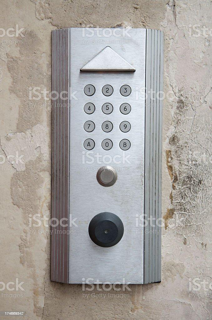 Modern Door Intercom Number Panel Old Wall royalty-free stock photo