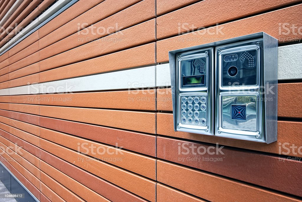 Modern door intercoms on the wall royalty-free stock photo