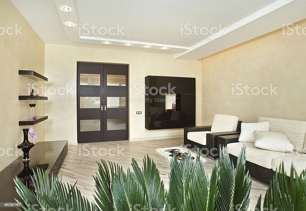 Modern Drawing-room interior in warm tones royalty-free stock photo