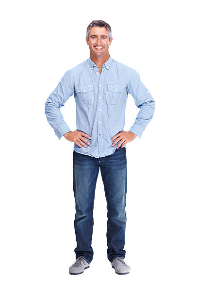 Modern easy going man Full-length portrait of a mature man standing with his hands on his hips - Isolated akimbo stock pictures, royalty-free photos & images