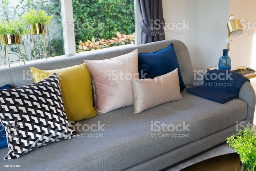 modern eclectic  living room with Colorful pillow on sofa