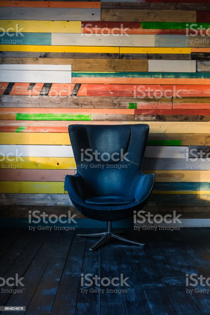 Modern egg chair on a colorful wooden wall royalty-free stock photo