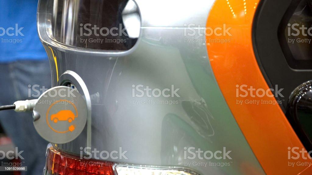 Modern electric car charging, environmental innovations,...