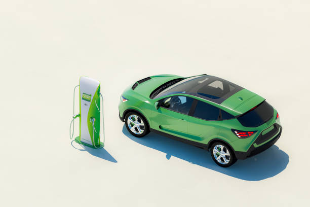 Modern electric car with electric charging station stock photo