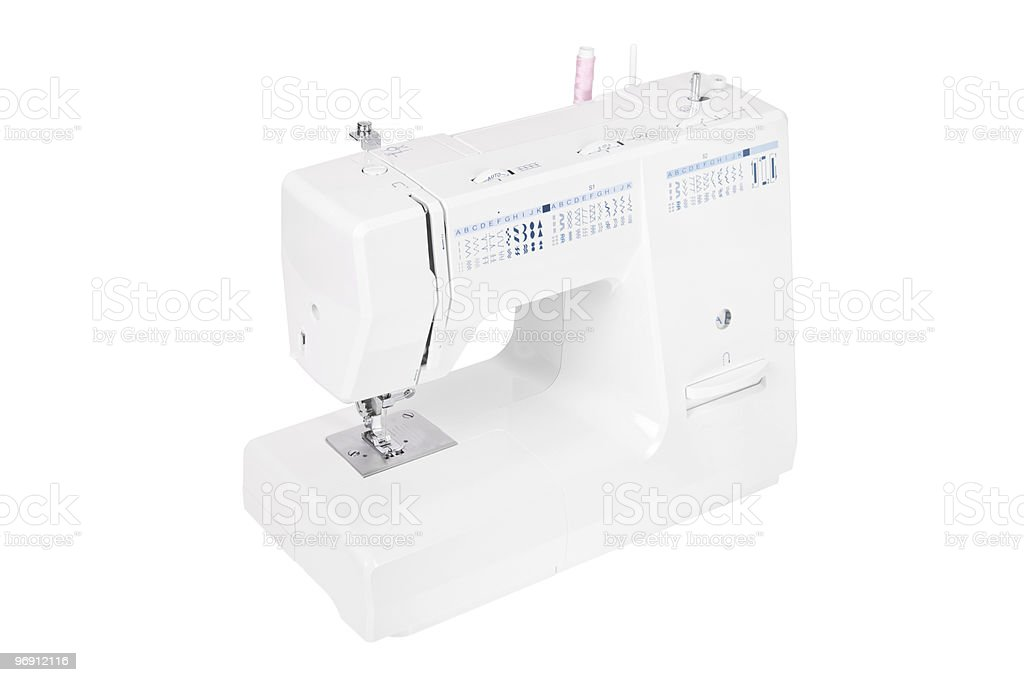 Modern electric sewing machine isolated on a white backdrop royalty-free stock photo